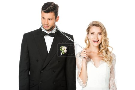 happy young bride with chain and leashed sad groom isolated on white
