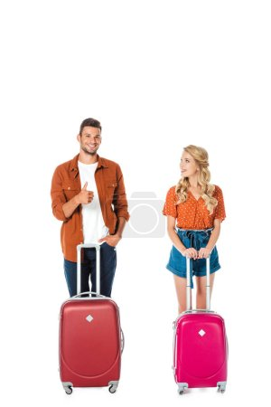 happy young couple with suitcases isolated on white