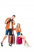 boyfriend holding binoculars and pointing on something to girlfriend isolated on white