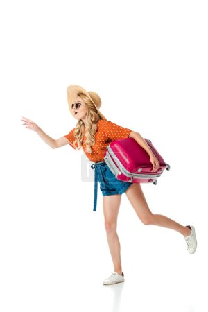 side view of beautiful girl running with travel bag isolated on white