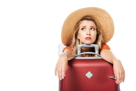 Photo for Exhausted beautiful leaning on travel bag and looking up isolated on white - Royalty Free Image