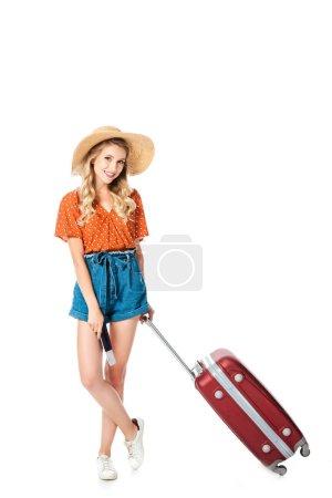 Photo pour Belle jeune fille debout avec sac de voyage, passeport et billet isolé sur blanc - image libre de droit