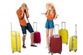shocked boyfriend looking at girlfriend luggage isolated on white