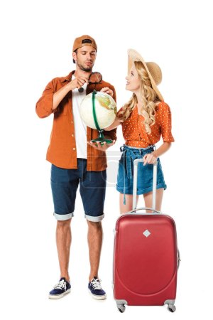 couple standing with globe and travel bag isolated on white