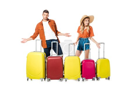 newlywed couple with arranged suitcases around isolated on white
