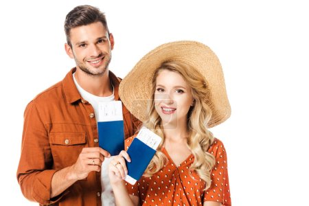 portrait of smiling couple showing passports and tickets in hands isolated on white