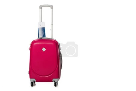 close up view of pink suitcase, passport and ticket isolated on white