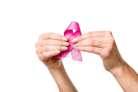 close-up partial view of woman holding pink ribbon isolated on white, breast cancer awareness concept