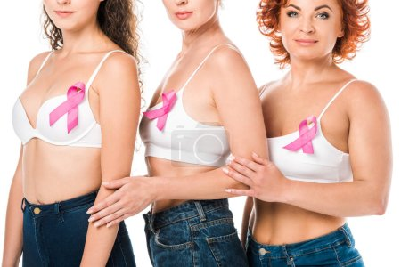 cropped shot of women in bras with breast cancer awareness ribbons standing isolated on white