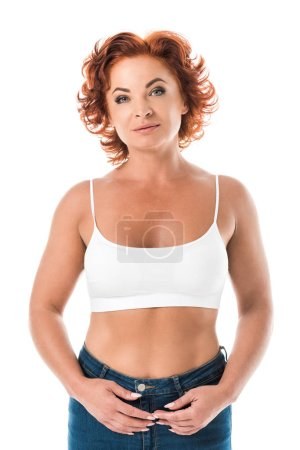 middle aged woman in bra looking at camera isolated on white