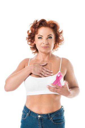 middle aged woman touching breast and looking at camera isolated on white, cancer awareness concept