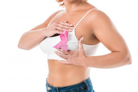 cropped shot of woman in white underwear with pink ribbon touching breast isolated on white, cancer awareness concept