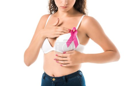cropped shot of woman in bra with pink ribbon checking breast, cancer awareness concept