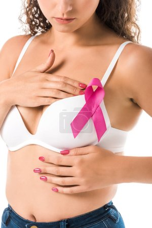 cropped shot of young woman in bra with pink ribbon checking breast, cancer awareness concept