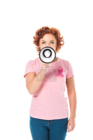 woman in pink t-shirt with breast cancer awareness ribbon holding megaphone and looking at camera isolated on white