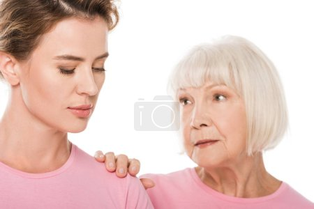 senior woman supporting upset woman isolated on white, breast cancer concept