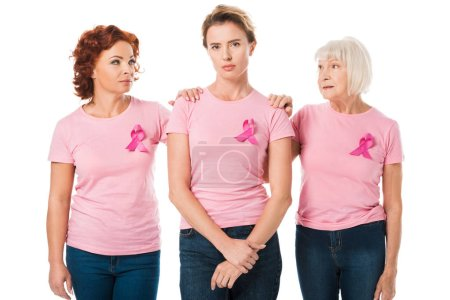women in pink t-shirts with breast cancer awareness ribbons standing together isolated on white
