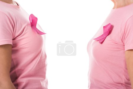 partial side view of women with pink ribbons isolated on white, breast cancer awareness concept