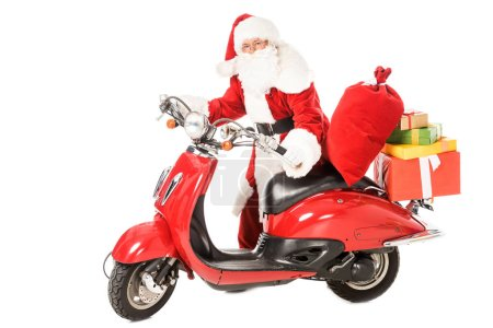 Photo for Santa claus pushing vintage red scooter with sacks and gift boxes isolated on white - Royalty Free Image