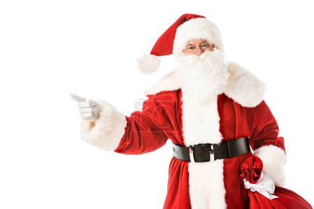 Photo for Santa claus pointing away while looking at camera isolated on white - Royalty Free Image
