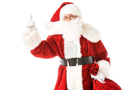 Photo for Santa claus pointing up while looking at camera isolated on white - Royalty Free Image