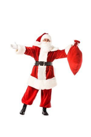 Photo for Santa claus with outstretched arms holding sack isolated on white - Royalty Free Image