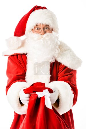 Photo for Emotional santa claus showing sack at camera isolated on white - Royalty Free Image