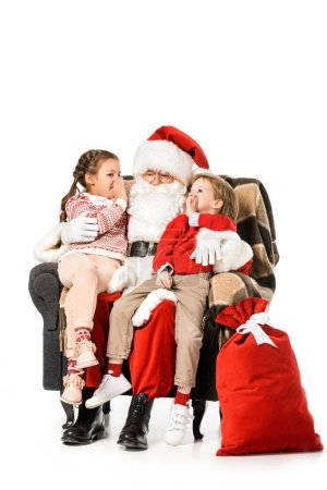 kids whispering to santa while thay sitting in armchair together isolated on white
