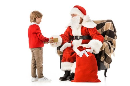 Photo for Santa presenting christmas gift to little kid isolated on white - Royalty Free Image
