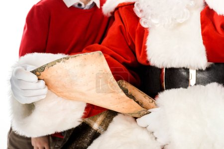 cropped shot of santa claus reading letter while kid standing beside him isolated on white