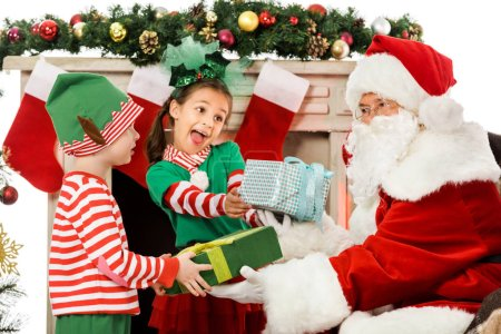 kids taking christmas gifts from santa claus isolated on white