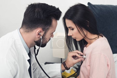 close-up shot of doctor listening breath of female patient