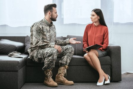 Photo for Soldier in military uniform with ptsd talking to psychiatrist at therapy session - Royalty Free Image