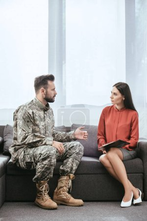 Photo for Angry soldier with ptsd talking to psychiatrist at therapy session - Royalty Free Image