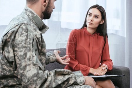 Photo for Depressed soldier with ptsd talking to psychiatrist at therapy session - Royalty Free Image