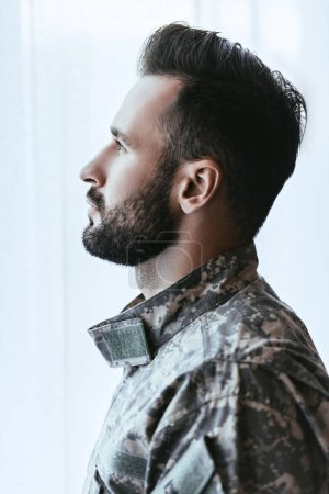 Photo for Side view of army man in military uniform looking up - Royalty Free Image