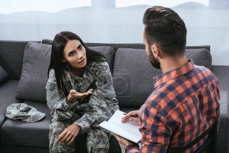 Photo for Angry female soldier with ptsd talking to psychiatrist at therapy session - Royalty Free Image
