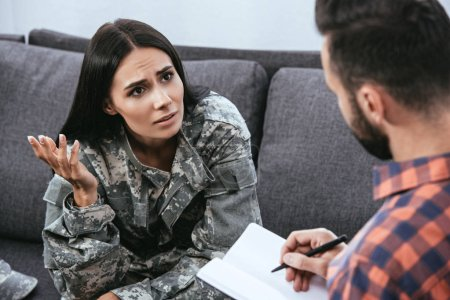 Photo for Depressed female soldier with ptsd talking to psychiatrist at therapy session - Royalty Free Image