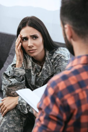 Photo for Depressed female soldier with ptsd sitting at therapy session with psychiatrist - Royalty Free Image