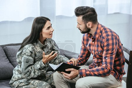 female soldier with post traumatic syndrome asking for help of psychiatrist during therapy