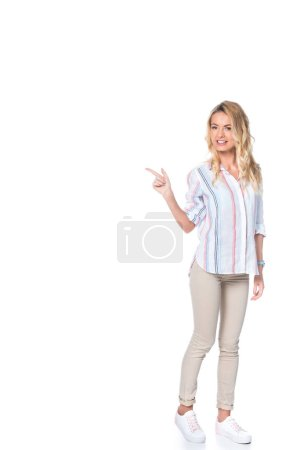 Photo for Happy woman pointing at something isolated on white - Royalty Free Image