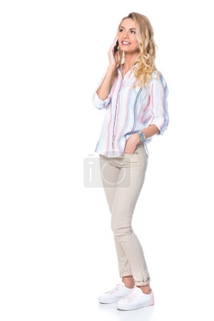 smiling woman talking on smartphone isolated on white