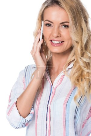 happy woman with blonde hair talking on smartphone isolated on white