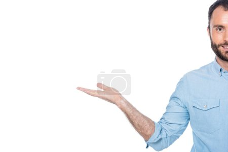 smiling man presenting something isolated on white