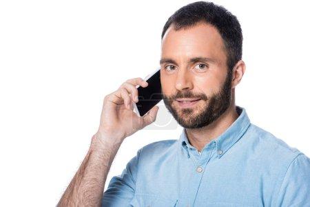 Photo pour Homme parle sur smartphone isolé sur blanc - image libre de droit