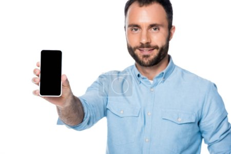 Photo for Man showing smartphone with blank screen isolated on white - Royalty Free Image