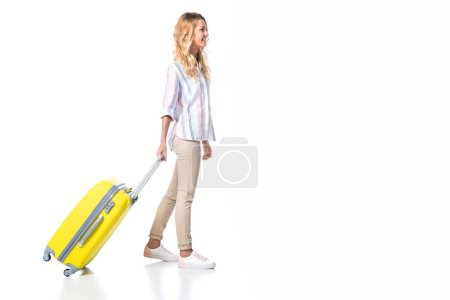 woman with yellow travel bag isolated on white