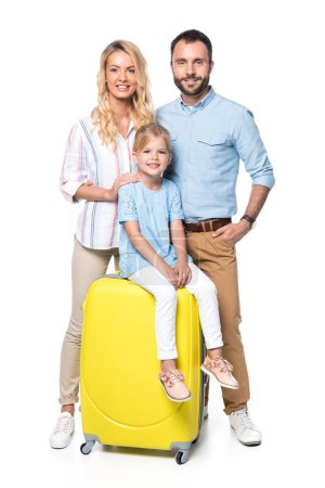 family with yellow suitcases looking at camera isolated on white