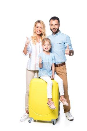 Photo pour Famille avec valises jaunes montrant pouces vers le haut isolé sur blanc - image libre de droit