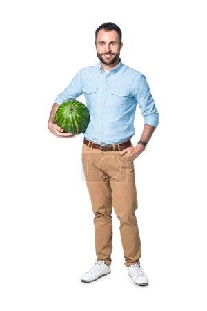 Photo pour Homme avec la pastèque vert isolé sur blanc - image libre de droit